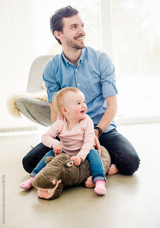 father playing with his young daughter by Andreas Gradin for Stocksy United