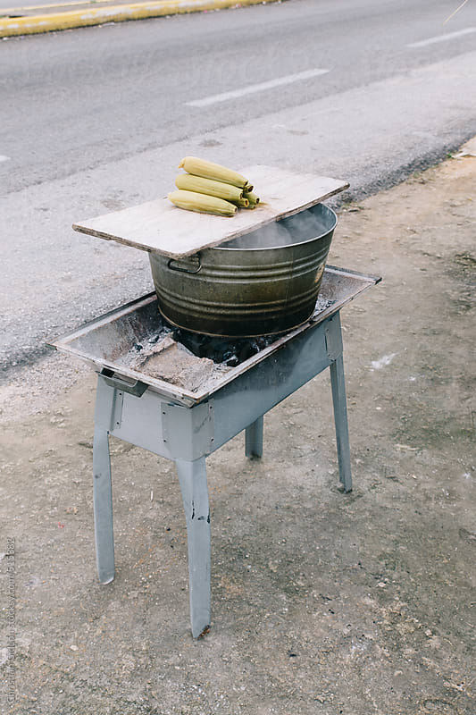 Plantains cooking roadside by Christian Gideon for Stocksy United