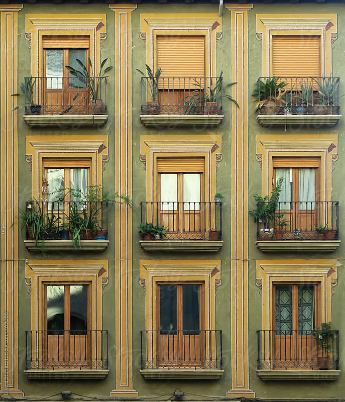 Beauty painted facade with balconies  by Bisual Studio for Stocksy United