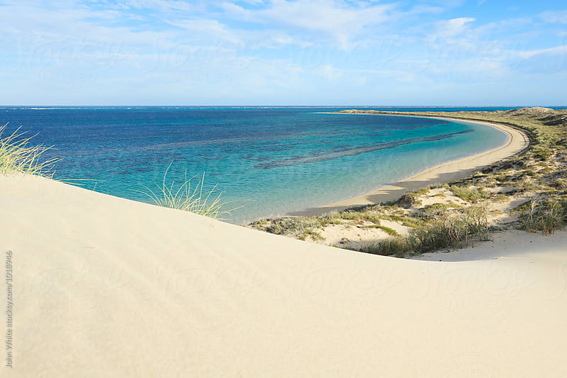 A sand dune at Ningaloo Reef. Coral Bay. Western Australia. by John White for Stocksy United