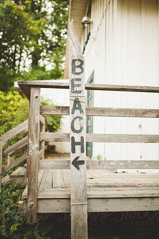 beach sign by Nate & Amanda Howard for Stocksy United