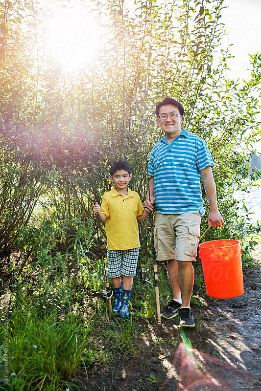 Asian father and his son going on a fishing trip to the lake by Suprijono Suharjoto for Stocksy United