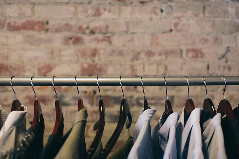 Men's clothes on a rack by Jeff Marsh for Stocksy United