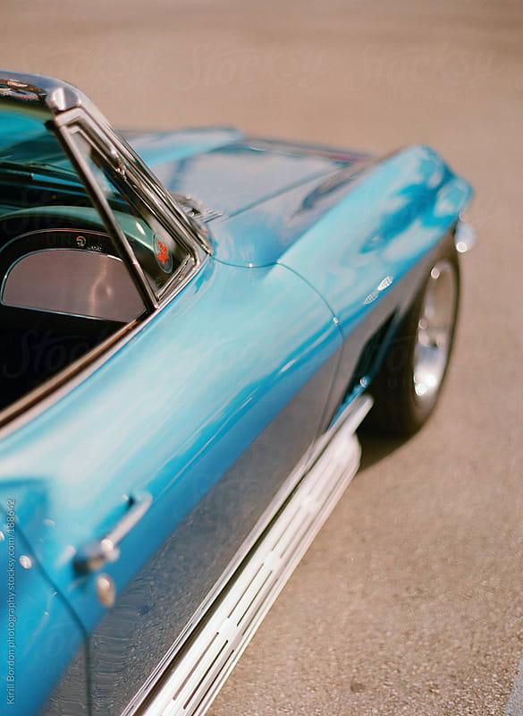 blue retro car by Kirill Bordon photography for Stocksy United