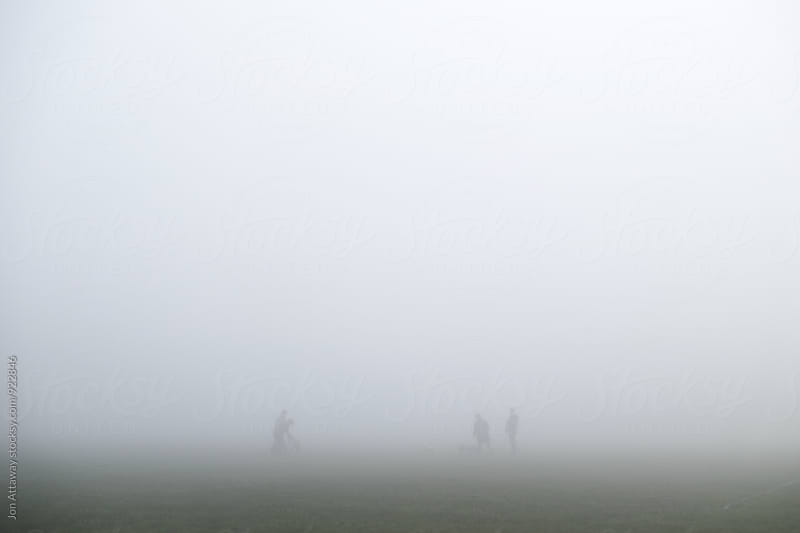 Ghostly figures in thick fog by Jon Attaway for Stocksy United