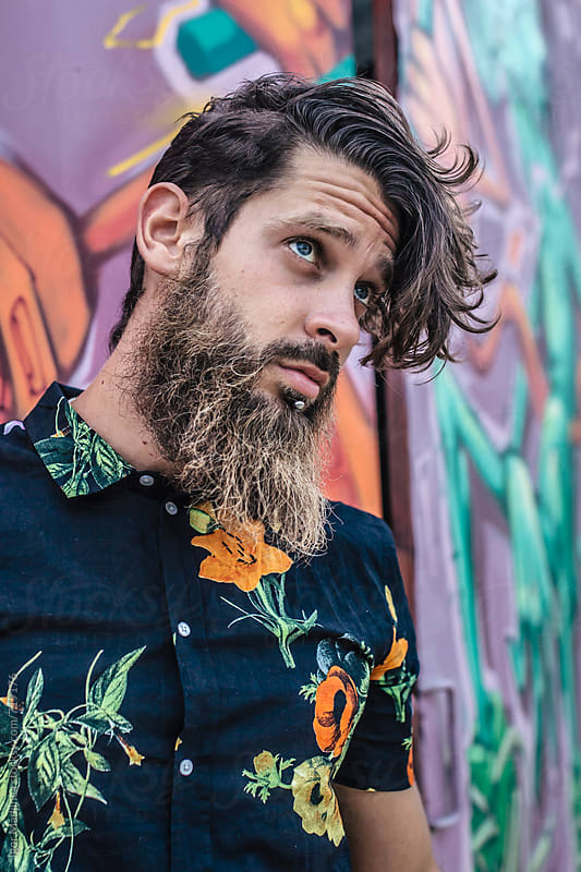 portrait of a young hipster man in colored shirt by Igor Madjinca for Stocksy United