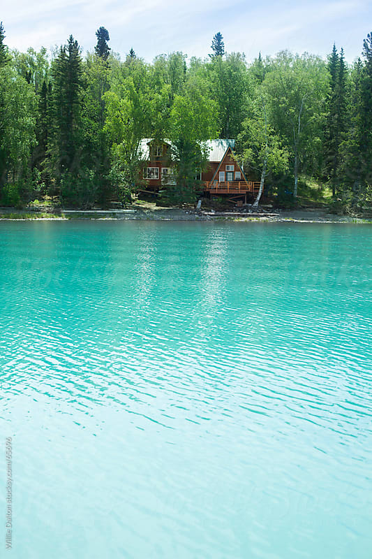 Log Cabin on a Turquoise Lake by Willie Dalton for Stocksy United