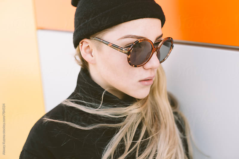 cool young woman with round sunglasses. by Alexey Kuzma for Stocksy United