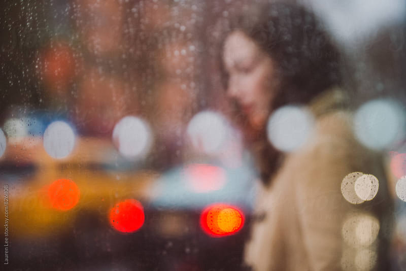 Blurred woman in traffic by Lauren Naefe for Stocksy United