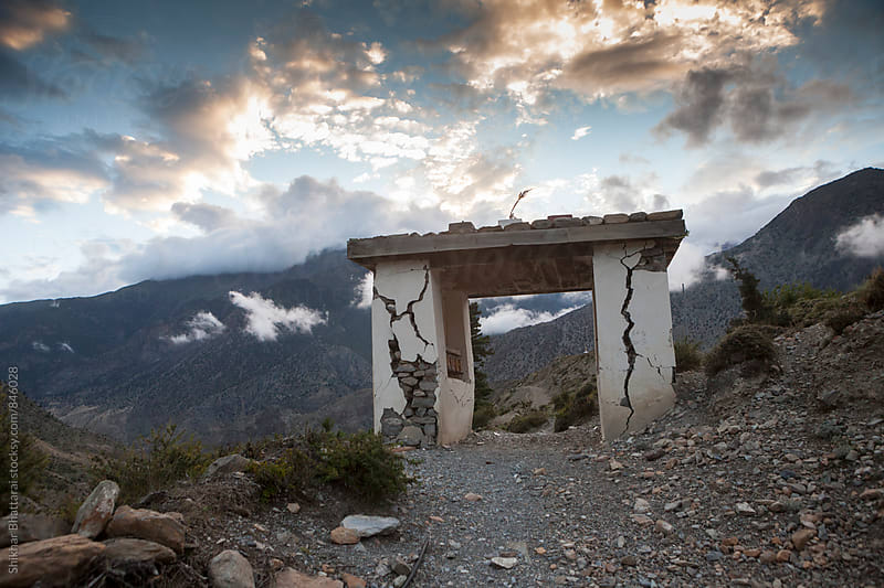 A broken gate in the himalayas after the Nepal earthquake. by Shikhar Bhattarai for Stocksy United