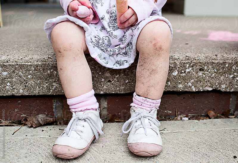 dirty legs on little girl by Maria Manco for Stocksy United
