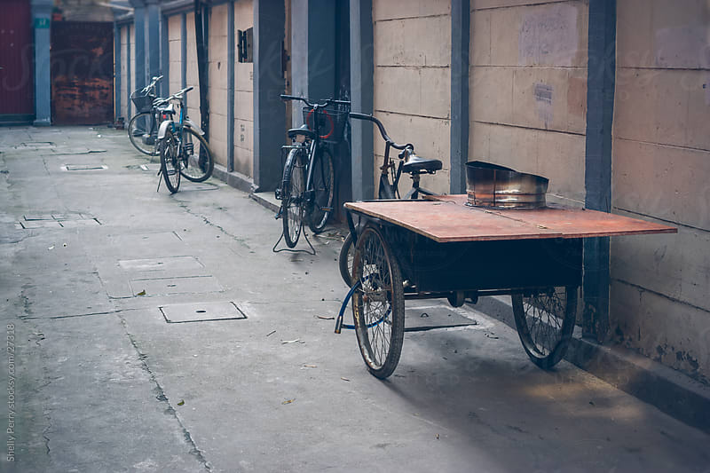 Bikes parked in an alley of Shanghai, China by Shelly Perry for Stocksy United