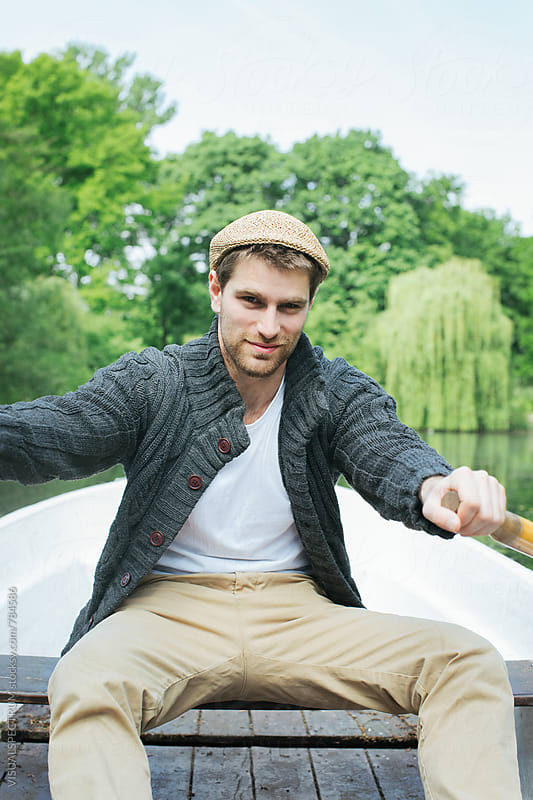 Portrait of Good-Looking Caucasian Man Rowing Boat on Lake by VISUALSPECTRUM for Stocksy United