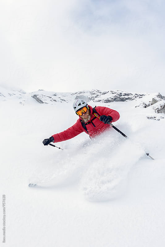 Freeskier moving fast and splashing with snow by RG&B Images for Stocksy United