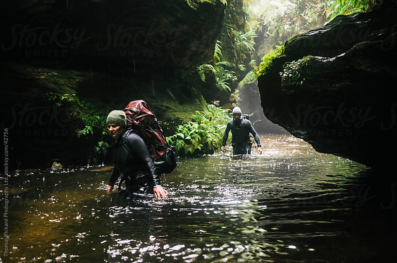 Male and female canyoners wading down Bell Creek Canyon, Blue Mountains Australia. by Thomas Pickard for Stocksy United