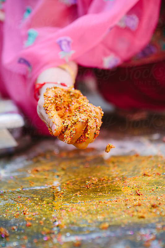 Collecting the Rangoli during a Mayian ceremony of a sikh wedding by kkgas for Stocksy United
