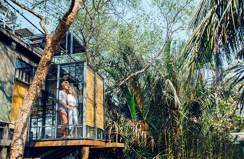 Young Couple in a Tropical Tree House by Lumina for Stocksy United