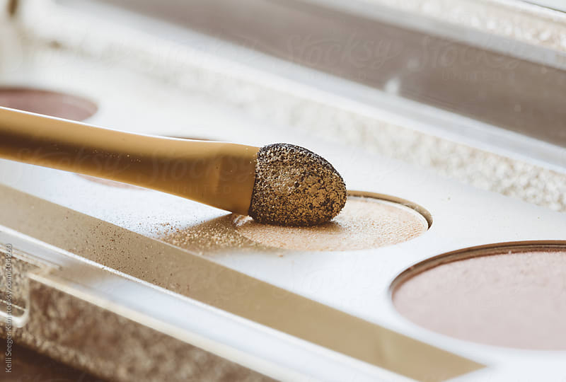 Macro Image Of Pretty Gold Eyeshadow And Applicator by Kelli Seeger Kim for Stocksy United