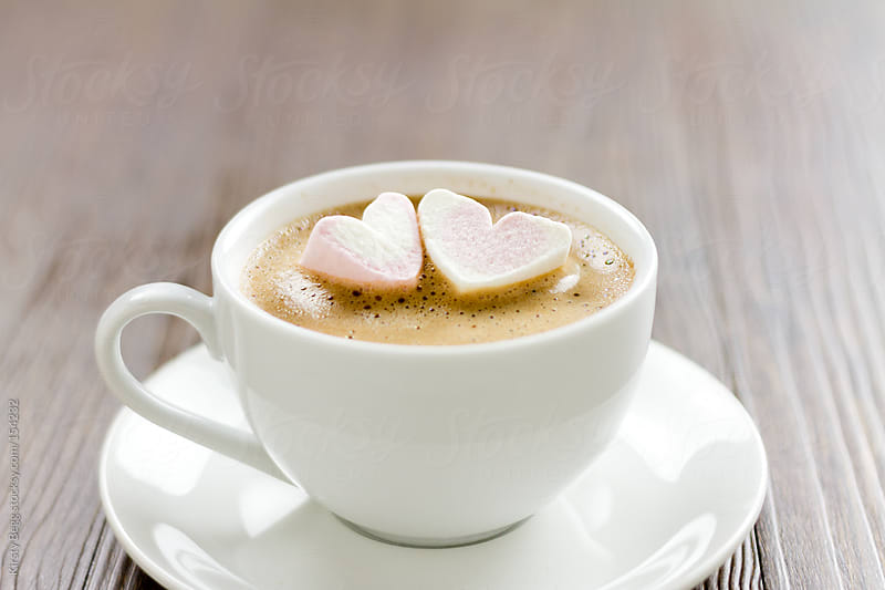 Two heart marshmallows in hot chocolate by Kirsty Begg for Stocksy United