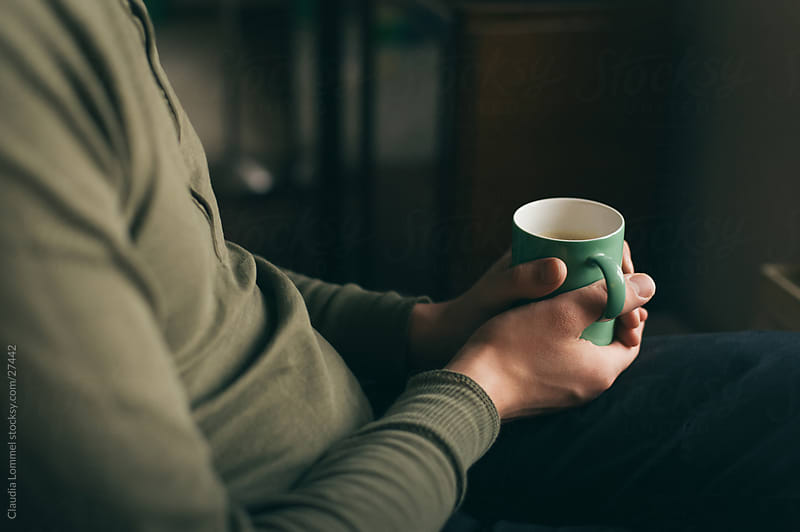 Relaxed Man Holding a Green  Mug by Claudia Lommel for Stocksy United