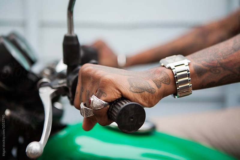 Tattooed hands on motorbike handlebars by kkgas for Stocksy United