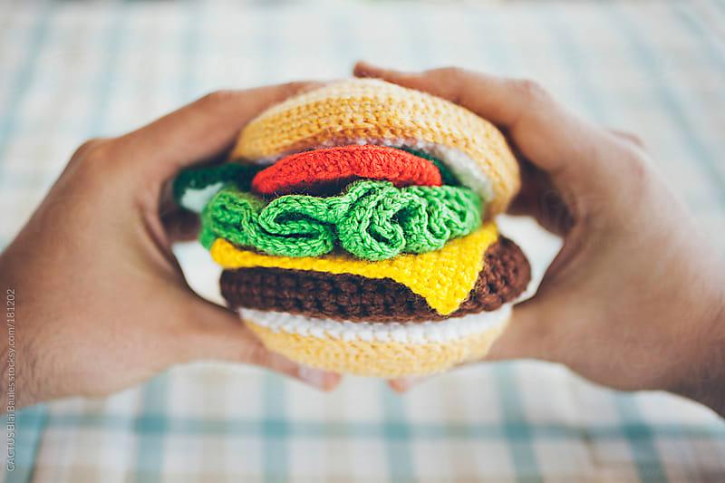 Eating a amigurumi hamburger by CACTUS Blai Baules for Stocksy United