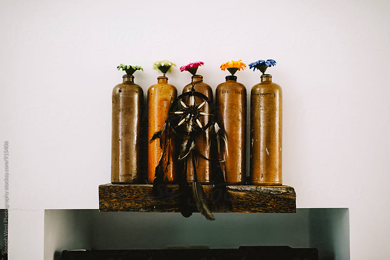 Colorful flowers in vases by Joseph West Photography for Stocksy United