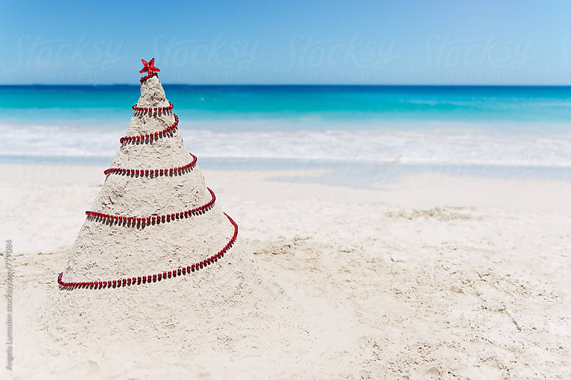 A sand christmas tree at the beach in Western Australia at Christmas by Angela Lumsden for Stocksy United