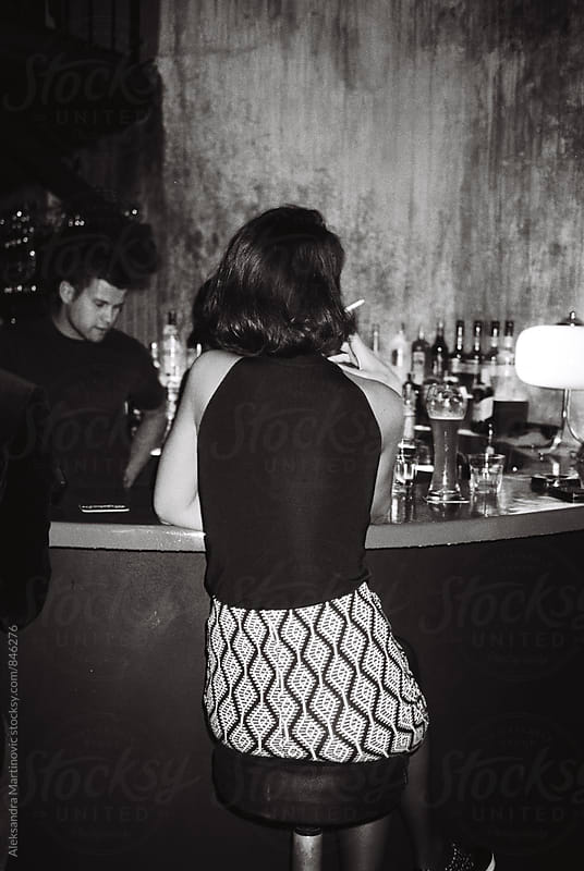 A young girl at the bar by Aleksandra Martinovic for Stocksy United