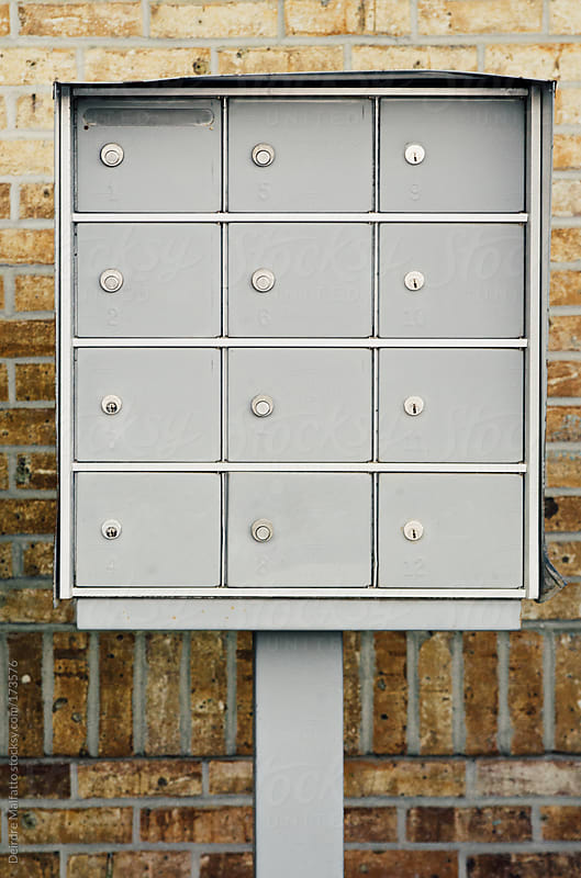 twelve mailboxes by Deirdre Malfatto for Stocksy United