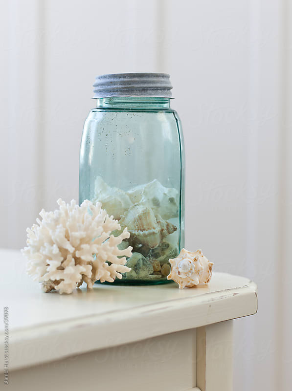 Jar of shells and coral by Daniel Hurst for Stocksy United