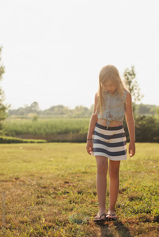 Cute Blonde Girl in a Striped Skirt by Lumina for Stocksy United