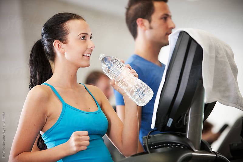 Gym: Treadmill Walker Drinking Water by Sean Locke for Stocksy United