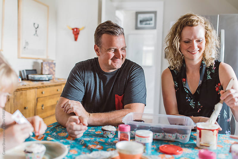 Couple making cupcakes together by Carey Shaw for Stocksy United