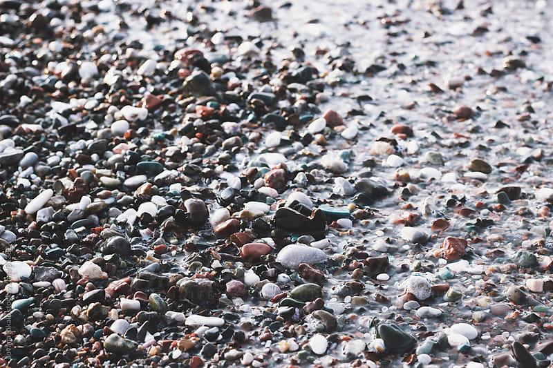 Stones in sea by Jovana Rikalo for Stocksy United