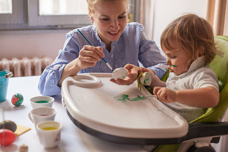 Mother and Son Painting Easter Eggs by Mosuno for Stocksy United