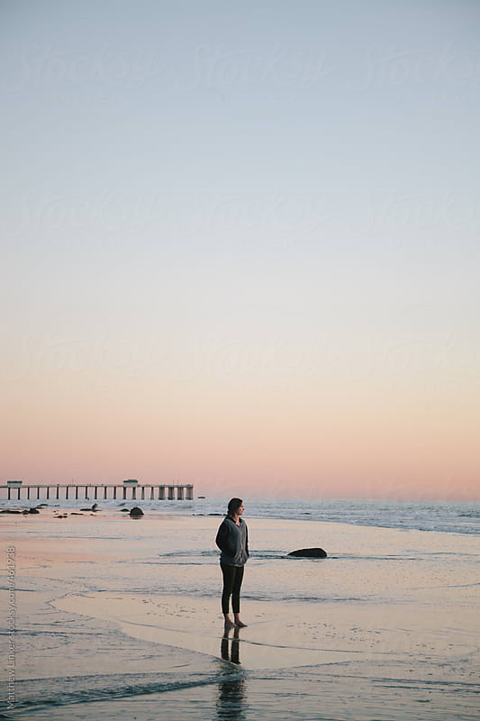 Evening Sunset walk on the beach  by Matthew Linker for Stocksy United