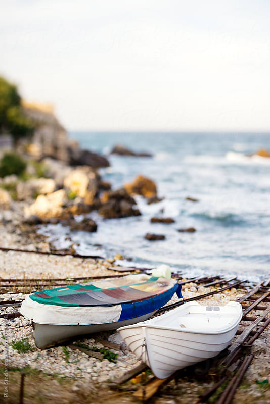 Boats on shore by Pixel Stories for Stocksy United