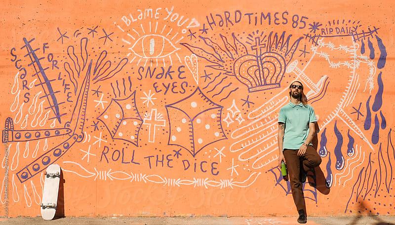 Portrait of hip young man/skateboarder.graffiti writer. by Audrey Shtecinjo for Stocksy United