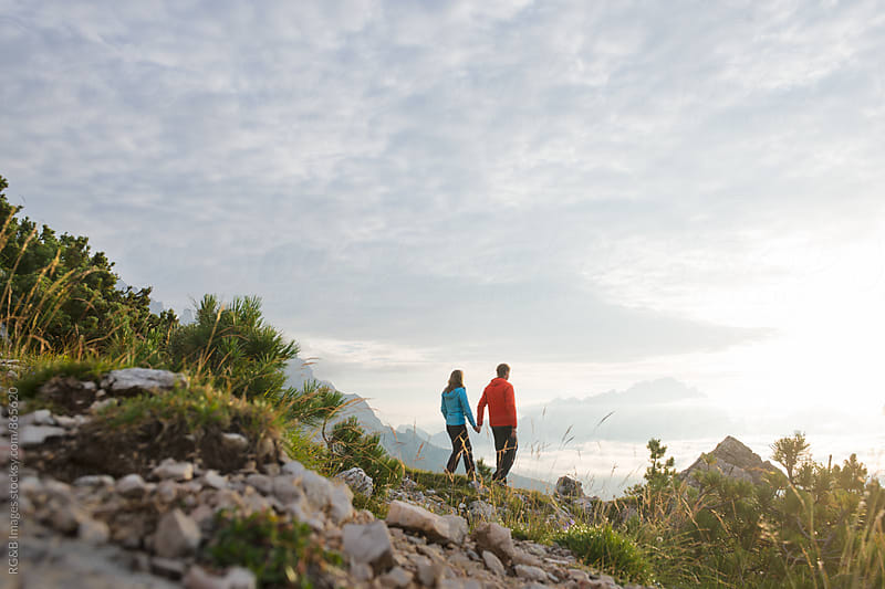 Couple hiking in the nature by RG&B Images for Stocksy United