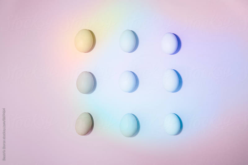 9 eggs arranges symmetrically by Beatrix Boros for Stocksy United