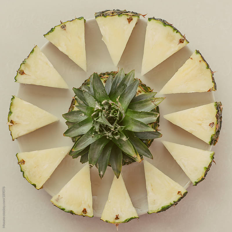 Cut Pineapple on a Plate by Mosuno for Stocksy United