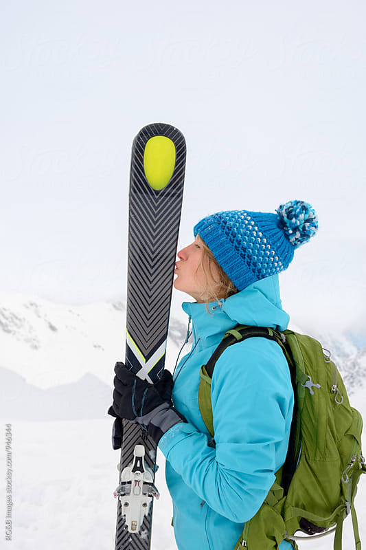Young woman kissing her skis by RG&B Images for Stocksy United