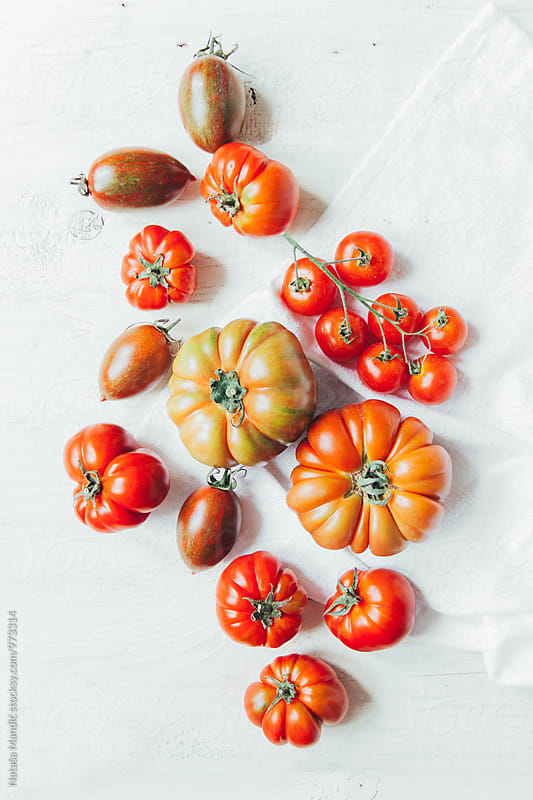 Tomatoes on white table by Nataša Mandić for Stocksy United