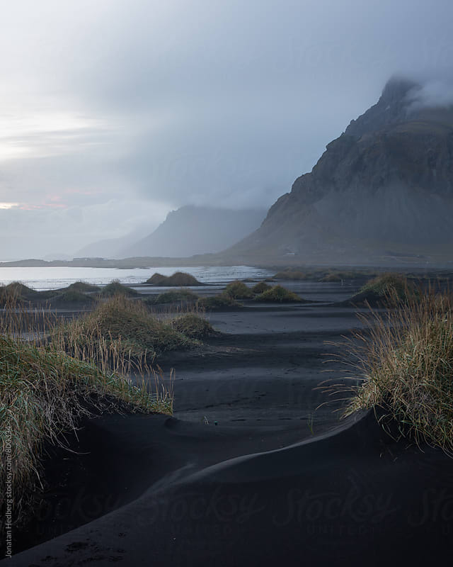 Dusk over black sand dunes in Stokksnes by Jonatan Hedberg for Stocksy United