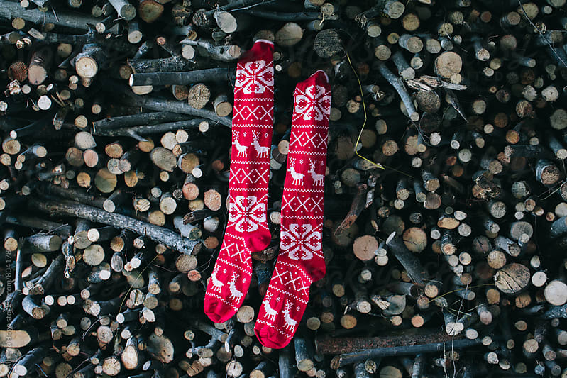 Christmas socks hanging by Alberto Bogo for Stocksy United