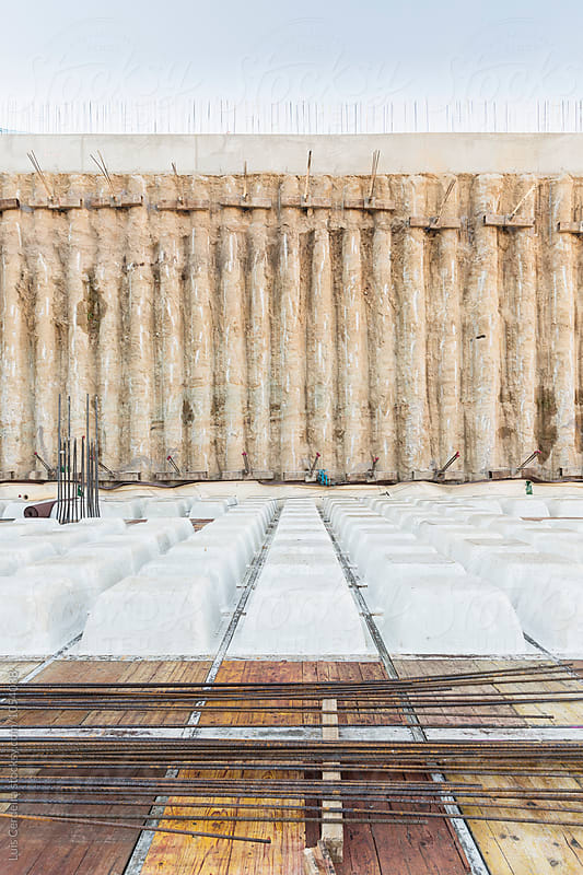 Reinforced concrete slab floor and foundation piles by Luis Cerdeira for Stocksy United