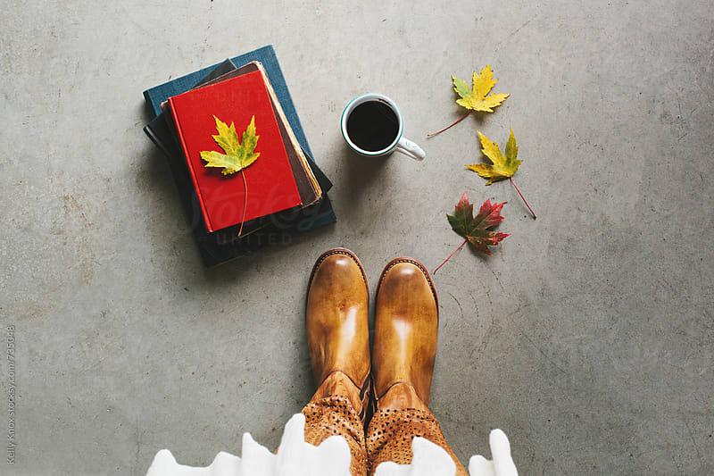 overhead of boots, books, coffee, and autumn leaves by Kelly Knox for Stocksy United