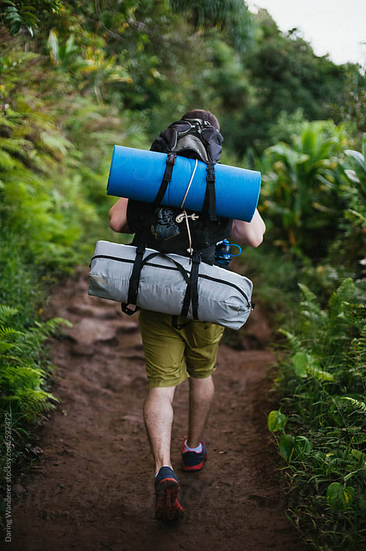 Young fit man hiking and backpacking in tropical paradise by Daring Wanderer for Stocksy United