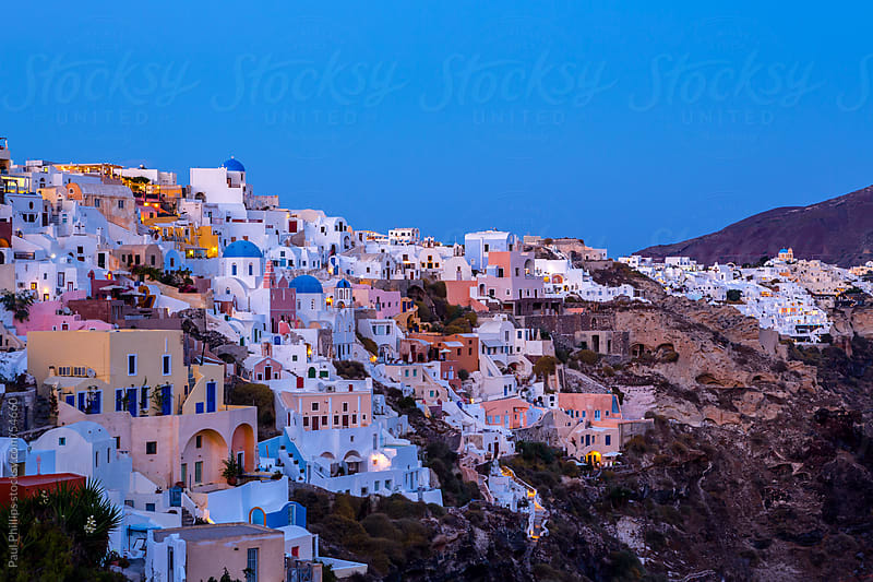 Twilight over Oia in Santorini, Greece. by Paul Phillips for Stocksy United